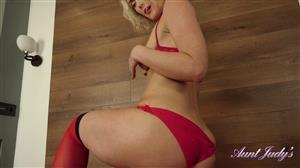 auntjudys-19-11-06-natie-lotions-up-and-masturbates-in-red-lingerie.jpg